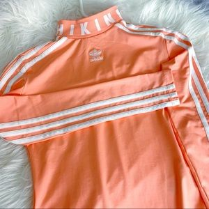 Adidas limited edition body suit.